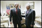 President George W. Bush and President Mahmoud Abbas of the Palestinian Authority share a moment before their joint press availability Thursday, Jan. 10, 2008, in Ramallah. White House photo by Eric Draper