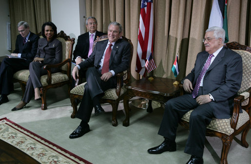 President George W. Bush and President Mahmoud Abbas of the Palestinian Authority, pause for photographs before the start of their expanded meeting Thursday, Jan. 10, 2008, at the President's Ramallah residence. With them are, from left: U.S. National Security Adviser Stephen Hadley, Secretary of State Condoleezza Rice, and Gamal Helal, White House Interpreter. White House photo by Chris Greenberg