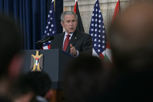 "President George W. Bush speaks during a joint press availability Thursday, Jan. 10, 2008, with President Mahmoud Abbas of the Palestinian Authority, in Ramallah. President Bush said of his counterpart, ""President Abbas was elected on a platform of peace. The conditions on the ground are very difficultÉ nevertheless, this man and his government not only works for a vision, but also works to improve the lives of the average citizens, which is essential for the emergence of a Palestinian democracy. White House photo by Chris Greenberg"