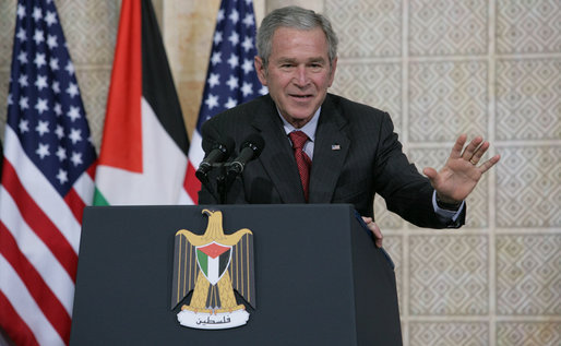 President George W. Bush responds to a reporter's question Thursday, Jan. 10, 2008, during a joint press availability with President Mahmoud Abbas of the Palestinian Authority, in Ramallah. White House photo by Chris Greenberg