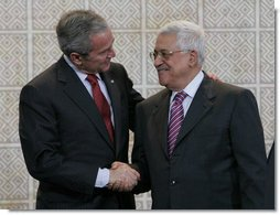 President George W. Bush and President Mahmoud Abbas exchange handshakes Thursday, Jan. 10, 2008, after a joint press availability at Muqata, the headquarters of the Palestinian Authority, in Ramallah. White House photo by Chris Greenberg