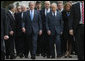 President George W. Bush walks with Israel's President Shimon Peres, right, and Prime Minister Ehud Olmert, center, as they arrive Friday, Jan. 11, 2008, to Yad Vashem, the Holocaust Museum, in Jerusalem, where the President laid a wreath in honor of Holocaust victims before departing Jerusalem for Galilee. White House photo by Eric Draper