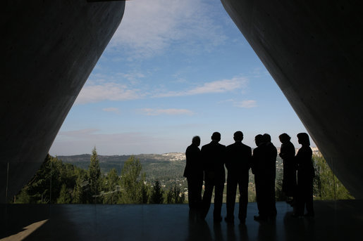 President George W. Bush, center, is silhouetted as he views Jerusalem from Yad Vashem, the Holocaust Museum, Friday, Jan. 11, 2008. The President was joined by Secretary of State Condoleezza Rice, right, Israel's Prime Minister Ehud Olmert, second from left, and Israel's President Shimon Peres during the visit. White House photo by Eric Draper