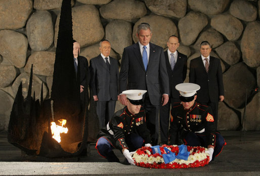 President George W. Bush bows his head as Marines lay a wreath on behalf of the United States of America, honoring the victims of the Holocaust, during a visit Friday, Jan. 11, 2008, to Yad Vashem, the Holocaust Museum in Jerusalem. White House photo by Eric Draper