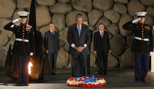 President George W. Bush pays his respect to the victims of the Holocaust during a visit Friday, Jan. 11, 2008, to Yad Vashem, the Holocaust Museum in Jerusalem. The President made the visit before proceeding to Galilee, his last stop before departing Israel for Kuwait. White House photo by Eric Draper