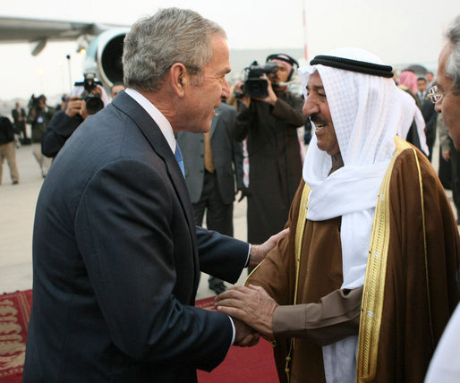 President George W. Bush is greeted by Amir Shaykh Sabah Al-Ahmed Al-Jaber Al Sabah after arriving Friday, Jan. 11, 2008, at Kuwait International Airport in Kuwait City. White House photo by Eric Draper