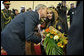 President George W. Bush gives a kiss on the cheek to a young girl Friday, Jan. 11, 2008, after she presented him with flowers upon his arrival at Kuwait International Airport in Kuwait City. White House photo by Eric Draper