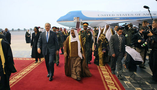 President George W. Bush and Amir Shaykh Sabah Al-Ahmed Al-Jaber Al Sabah walk a red carpet to arrival ceremonies Friday, Jan. 11, 2008, at Kuwait International Airport in Kuwait City after the President arrived from Israel on the second stop of his eight-day, Mideast visit. White House photo by Eric Draper