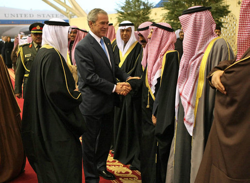 President George W. Bush is greeted by a Kuwaiti welcoming delegation Friday, Jan. 11, 2008, during the arrival ceremonies at Kuwait International Airport in Kuwait City, the second stop on the President's eight-day, Mideast visit. White House photo by Eric Draper