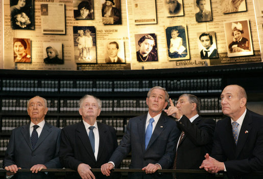 President George W. Bush listens to Avner Shalev, Chairman of the Yad Vashem Directorate, as he visits the Hall of Names in Yad Vashem, the Holocaust Museum, in Jerusalem Friday, Jan. 11, 2008. Joining the President in the visit are, from left, President Shimon Peres, of Israel; Josef Lapid, Chairman of the Yad Vashem Council, and Israel's Prime Minister Ehud Olmert. White House photo by Chris Greenberg
