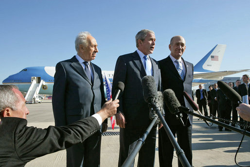 President George W. Bush speaks to the media Friday, Jan. 11, 2008, as he stands with President Shimon Peres of Israel, right, and Prime Minister Ehud Olmert at Tel Aviv's Ben Gurion International Airport. The President concluded his two-day visit to Israel with a visit to Yad Vashem, the Holocaust Museum in Jerusalem, and the ruins of Capernaum on the Sea of Galilee. White House photo by Chris Greenberg