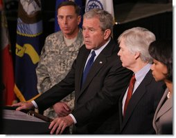 Flanked by Gen. David Petraeus, Commander of the Multi-National Force in Iraq, U.S. Ambassador to Iraq, Ryan Crocker and Secretary of State Dr. Condoleezza Rice, President George W. Bush delivers a statement Saturday, Jan. 12, 2008, during a visit to Camp Arifjan before departing Kuwait. White House photo by Eric Draper