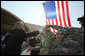President George W. Bush reaches out to shake the hands of troops Saturday, Jan. 12, 2008, during his visit to Camp Arifjan, the last stop in his Kuwait tour before continuing on to Bahrain. White House photo by Eric Draper