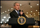 President George W. Bush delivers a statement Saturday, Jan. 12, 2008, after meeting with Gen. David Petraeus, Commander of the Multi-National Forces in Iraq, and U.S. Ambassador to Iraq Ryan Crocker at Camp Arifjan in Kuwait. White House photo by Chris Greenberg