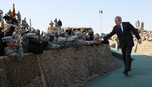 President George W. Bush reaches out to troops at Camp Arifjan in Kuwait Saturday, Jan. 12, 2008, during his last stop in the country before continuing on to Bahrain. White House photo by Eric Draper