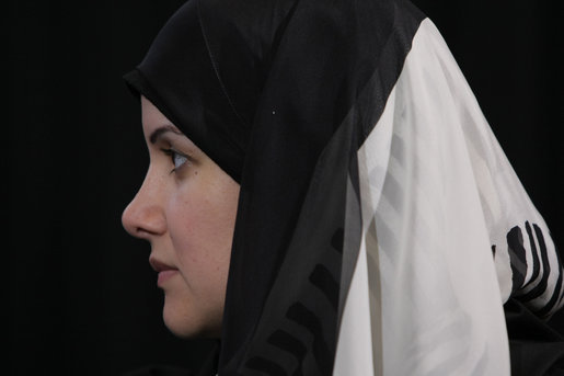 "A participant listens to President George W. Bush as he joins a roundtable discussion Saturday, Jan. 12, 2008, on democracy and development with Kuwaiti women in Kuwait City. The President told the women, ""All societies are enriched by the participation of women. I happen to believe very strongly in the freedom agenda and I think an integral part of that agenda is making sure that all participants in society have got an equal voice."" White House photo by Eric Draper"