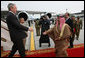 President George W. Bush reaches out to King Hamad Bin Isa Al-Khalifa as he deplanes Air Force One Saturday, Jan. 12, 2008, after arriving at Bahrain International Airport in Manama, Bahrain. White House photo by Eric Draper