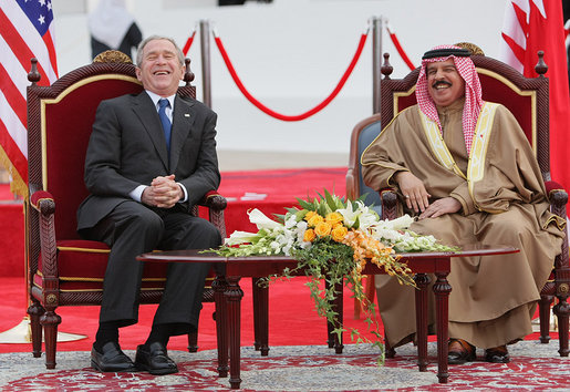 President George W. Bush and King Hamad Bin Isa Al-Khalifa break out in laughter as they sit on stage for the arrival ceremonies welcoming President Bush to Bahrain Saturday, Jan. 12, 2008, in Manama. White House photo by Eric Draper