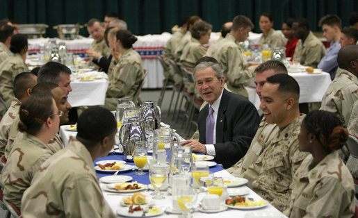 President George W. Bush joins military personnel and coalition forces for breakfast Sunday, Jan. 13, 2008 in Manama, Bahrain. The President took the opportunity to visit the U.S. Naval Forces Central Command before departing Bahrain for Abu Dhabi, United Arab Emirates. White House photo by Eric Draper