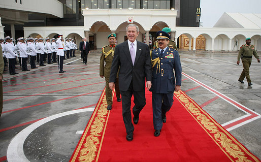 President George W. Bush and King Hamad Bin Isa Al-Khalifa walk past an honor cordon Sunday, Jan. 13, 2008, at Bahrain International Airport in Manama prior to the President's departure for Abu Dhabi, United Arab Emirates. White House photo by Eric Draper