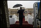 With umbrella in hand, President George W. Bush waves from aboard Air Force One as he prepares to deplane after arriving Sunday, Jan. 13, 2008, at Abu Dhabi International Airport. White House photo by Eric Draper