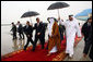 President George W. Bush and President Sheikh Khalifa bin Zayed Al Nayhan of the United Arab Emirates, walk the red carpet after the arrival Sunday, Jan. 13, 2008, of President Bush at Abu Dhabi International Airport. White House photo by Eric Draper