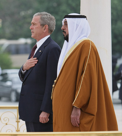 President George W. Bush and President Sheikh Khalifa bin Zayed Al Nahyan of the United Arab Emirates, stand for their national anthems Sunday, Jan. 13, 2008, during arrival ceremonies for President Bush at Al Mushref Palace in Abu Dhabi. White House photo by Eric Draper
