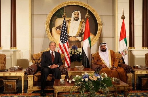 President George W. Bush and President Sheikh Khalifa bin Zayed Al Nahyan of the United Arab Emirates sit under a painting of the Sheikh's father, Sheikh Zayed bin Sultan Al Nahyan, during arrival ceremonies Sunday, Jan. 13, 2008, at Al Mushref Palace in Abu Dhabi. White House photo by Eric Draper
