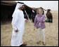 As Sheikh Abdullah bin Zayed Al Nahyan, United Arab Emirates Minister of Foreign Affairs looks on, White House Press Secretary Dana Perino holds a falcon Sunday, Jan. 13, 2008, during a dinner in the desert near Abu Dhabi. White House photo by Eric Draper