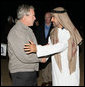 Crown Prince Sheikh Mohammed bin Zayed Al Nayhan and President George W. Bush embrace as they conclude their dinner in the desert Sunday, Jan. 13, 2008, near Abu Dhabi. President Bush will depart the United Arab Emirates Monday, continuing on to Saudi Arabia on the last leg of his Mideast visit. White House photo by Eric Draper