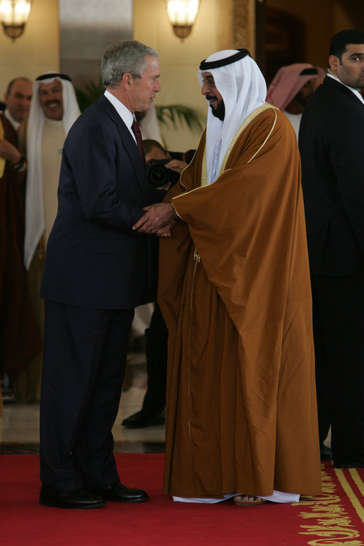 President George W. Bush shakes hands with Sheikh Khalifa bin Zayed Al Nahyan, President of the United Arab Emirates, Sunday, Jan. 13, 2008, following arrival ceremonies at Al Mushref Palace in Abu Dhabi. White House photo by Chris Greenberg