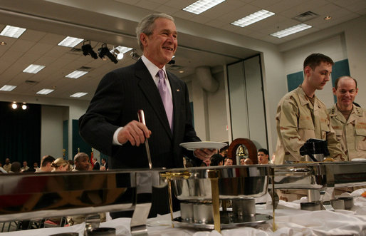 President George W. Bush serves up some breakfast for himself Sunday, Jan. 13, 2008, during a visit to the U.S. Naval Forces Central Command in Manama, Bahrain, where he visited with military personnel and coalition forces. White House photo by Chris Greenberg