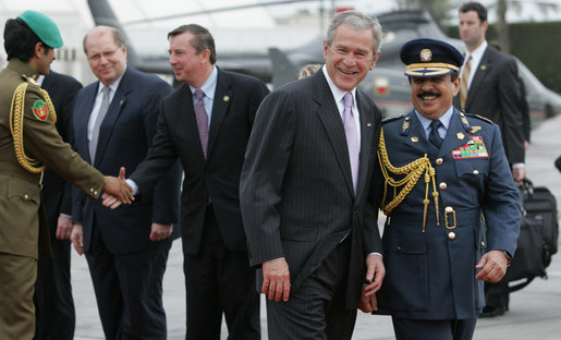 President George W. Bush walks with Bahrain's King Hamad Bin Isa Al-Khalifa at Bahrain International Airport Sunday morning, Jan. 13, 2008, as he prepares to depart Manama for the United Arab Emirates. White House photo by Chris Greenberg