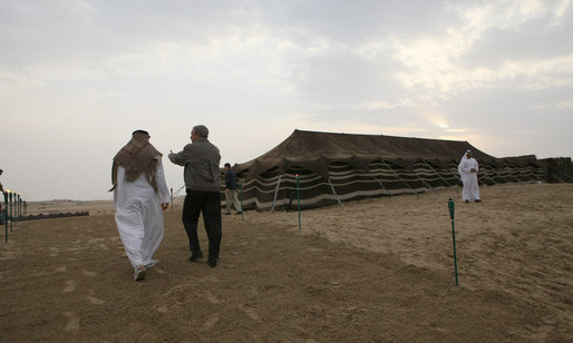 President George W. Bush and Crown Prince Sheikh Mohammed bin Zayed Al Nayhan walk a path in the desert prior to dinner Sunday, Jan. 13, 2008, near Abu Dhabi. White House photo by Eric Draper