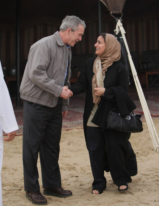 President George W. Bush shares a moment with Sheikha Lubna Khalid Al Qasimi, United Arab Emirates Minister of Economy and Planning, during dinner Sunday, Jan. 13, 2008, in the desert near Abu Dhabi. White House photo by Eric Draper