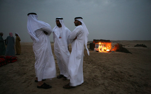 Guests mingle near open fires in the desert near Abu Dhabi Sunday, Jan. 13, 2008, during a dinner with President George W. Bush and Crown Prince Sheikh Mohammed bin Zayed Al Nayhan. White House photo by Eric Draper