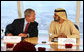 With Dubai as a backdrop, President George W. Bush and Sheikh Mohammed bin Rashid Al Maktoum participate in a roundtable discussion Monday, Jan. 14, 2008, with young Arab leaders at the Burj Al Arab Hotel. White House photo by Eric Draper
