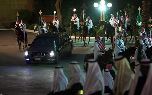 The limousine carrying President George W. Bush from Riyadh-King Khaled International Airport arrives at the Guest Palace in Riyadh Monday, Jan. 14, 2008, accompanied by a ceremonial horse procession. White House photo by Eric Draper