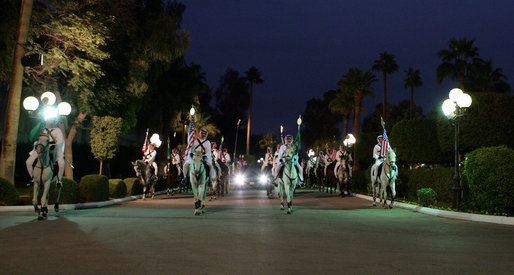 Escorted by a ceremonial horse procession, the limousine carrying President George W. Bush arrives at the Guest Palace Monday, Jan. 14, 2008, in Riyadh, Saudi Arabia. White House photo by Chris Greenberg