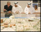 President George W. Bush listens to plans for the future of Abu Dhabi during a tour Monday, Jan. 14, 2008, of the Saadiyat Island Cultural District Exhibition and Masdar Exhibition at the Emirates Palace Hotel. White House photo by Eric Draper