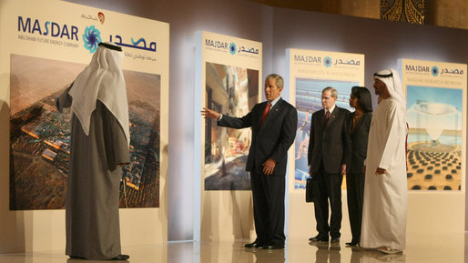 President George W. Bush points to a display in the Masdar Exhibition Monday, Jan. 14, 2008, at the Emirates Palace Hotel. Created in 2006, Masdar is a global cooperative platform for open engagement in the search for solutions to some of mankind's most pressing issues, such as energy security, climate change and truly sustainable human development. White House photo by Eric Draper