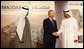 President George W. Bush shakes hands with Crown Prince Sheikh Mohammed bin Zayed Al Nahyan after viewing exhibitions Monday, Jan. 14, 2008, on the future of the United Arab Emirates at the Emirates Palace Hotel in Abu Dhabi. White House photo by Eric Draper