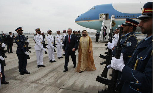 President George W. Bush walks through an honor guard with Sheikh Mohammed bin Rashid al-Maktoum, Vice President and Prime Minister of the United Arab Emirates, Monday, Jan. 14, 2008, upon arrival to Dubai. White House photo by Eric Draper