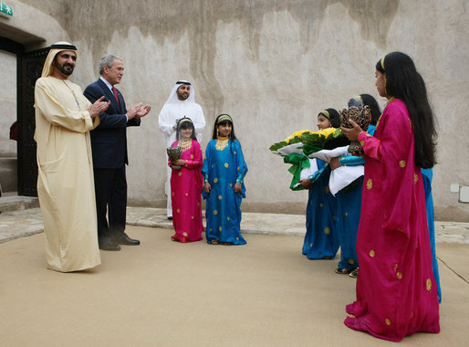 President George W. Bush and Sheikh Mohammed Bin Rashid al-Maktoum, Vice President and Prime Minister of the United Arab Emirates, applaud a children's dance group welcoming President Bush, Monday, Jan. 14, 2008, to Sheikh Saeed Al Maktoum House in Dubai. White House photo by Eric Draper