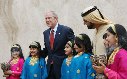 President George W. Bush and Sheikh Mohammed Bin Rashid al-Maktoum, Vice President and Prime Minister of the United Arab Emirates, pose for photos with a children's dance group welcoming President Bush, Monday, Jan. 14, 2008, during a visit to Sheikh Saeed Al Maktoum House in Dubai. White House photo by Eric Draper