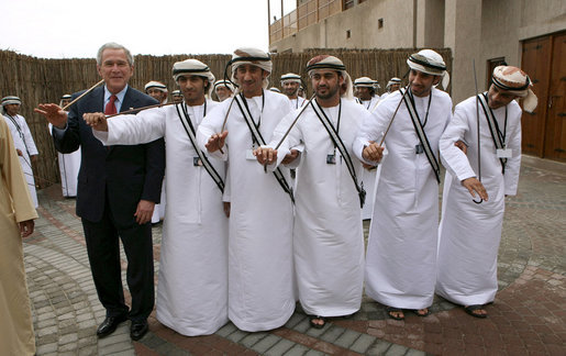President George W. Bush poses with a group of traditional dancers, Monday, Jan. 14, 2008, during a visit to the Sheikh Saeed Maktoum House, home of Vice President and Prime Minister of the United Arab Emirates Sheikh Mohammed bin Rashid al-Maktoum, in Dubai. White House photo by Eric Draper