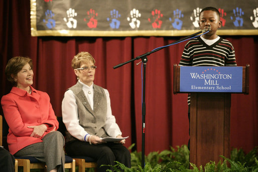 "Mrs. Laura Bush and Dr. Tish Howard, Principal, Washington Mill Elementary School, listen as Damien Floyd, Student, reads an essay he wrote on George Washington, during a Mount Vernon's ""George Washington's Return to School"" ceremony at Washington Mill Elementary School Tuesday, January 15, 2008, in Alexandria, Virginia. The ""Portrait of Leadership"" initiative was planned to coincide with the 275th birthday year of George Washington, celebrated in February of 2007, to help put a portrait of George Washington in class rooms in all fifty states. White House photo by Shealah Craighead"