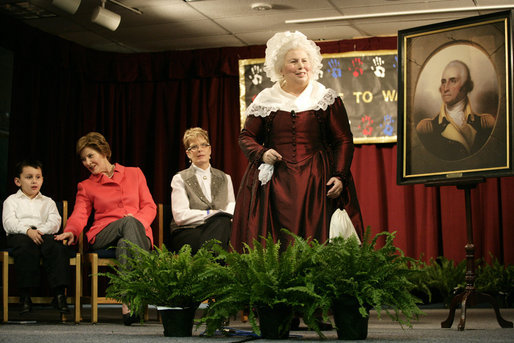 "Ms. Mary Wiseman, Martha Washington Re-enactor, Mount Vernon Estate and Gardens, leads Mrs. Laura Bush, Santiago Echeverria, Student, and Dr. Tish Howard, Principal, Washington Mill Elementary School, in a ceremony at Washington Mill Elementary School Tuesday, January 15, 2008, in Alexandria, Virginia, to celebrate Mount Vernon's ""George Washington's Return to School"" program. The ""Portrait of Leadership"" initiative was planned to coincide with the 275th birthday year of George Washington, celebrated in February of 2007, to help put a portrait of George Washington in class rooms in all fifty states. White House photo by Shealah Craighead"