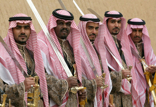 Sword dancers pose for a photograph Tuesday, Jan. 15, 2008, as they await the arrival of President George W. Bush to Al Murabba Palace in Riyadh. The President spent his last day in Saudi Arabia participating in a roundtable, visiting the King's Palace and National History Museum, and spending the evening at Al Janadriyah, the King's ranch. White House photo by Eric Draper