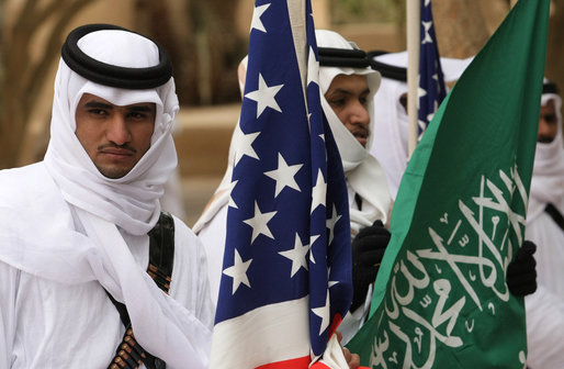 A Saudi honor guard stands with the U.S. and Saudi flags Tuesday, Jan. 15, 2008, awaiting the arrival of President George W. Bush to Al Murabba Palace in Riyadh. White House photo by Chris Greenberg